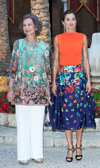 While Queen Letizia stepped out with Queen Sofia for a dinner at the Almudaina Palace on Aug. 3, the mother of two stunned in a Hugo Boss 'Fasmine' Orange Ribbed Mockneck Knit Shell tank top paired with a floral Carolina Herrera skirt and Magrit sandals. 