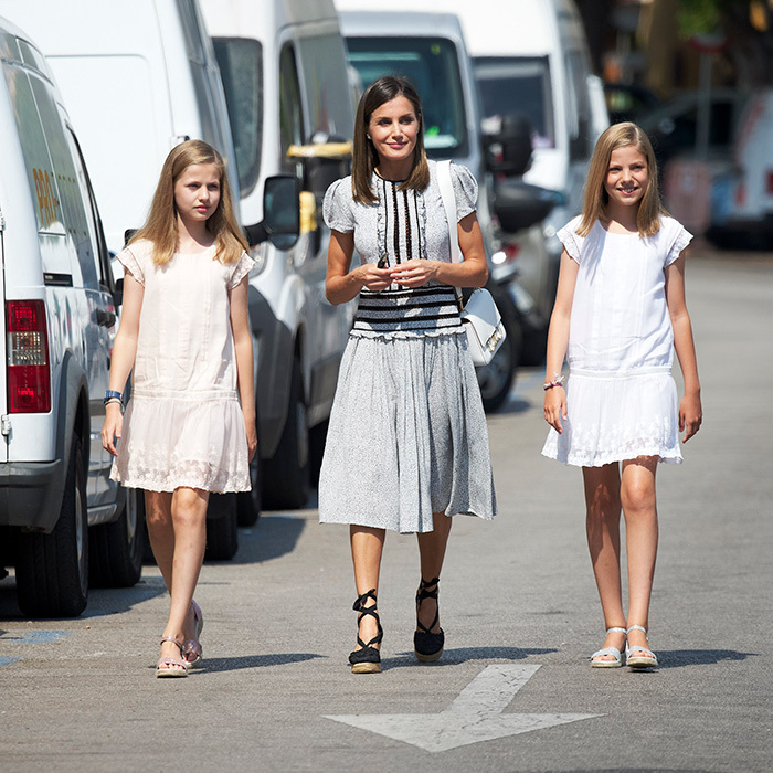 Princess Leonor and Princess Sofia looked sweet in matching dresses and shoes alongside their fashionable mom, Queen Letizia, who wore a new black-and-white dress, a Carolina Herrera bag and sunglasses, and Gaimo 'Argo' black embroidered tie-up espadrilles.