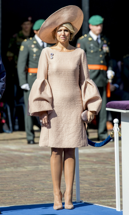 Queen Maxima of the Netherlands looked picture perfect in head-to-toe blush pink at a military ceremony on Aug 31. The dramatic bell sleeves are the perfect complement to the mother of three's trademark oversized hat. 