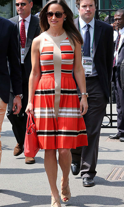 Pippa stepped out in a stunning striped dress with some nude peep toe shoes and a red leather bag.