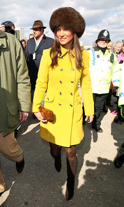 Prince George's aunt kept warm in a bright yellow coat with a fur hat for a hint of glamour.