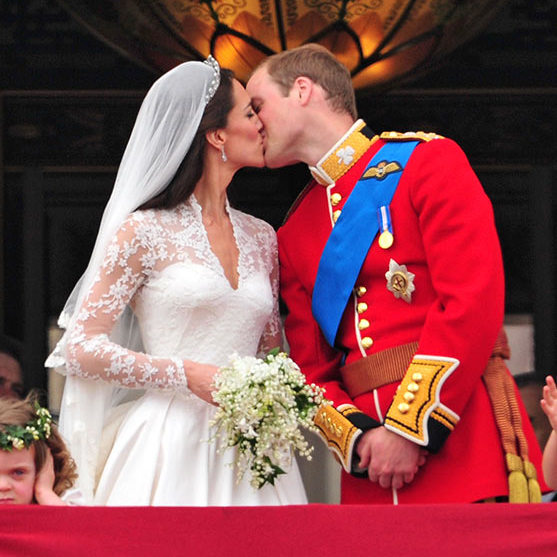 Crowds lined the streets, waving Union Jack flags and cheering and applauding with delight as the newlyweds kissed on the balcony of Buckingham Palace.