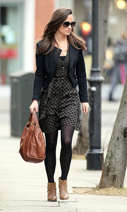 Pippa kept it simple in a tan-and-black print dress, black blazer, tan booties and brown bag.
