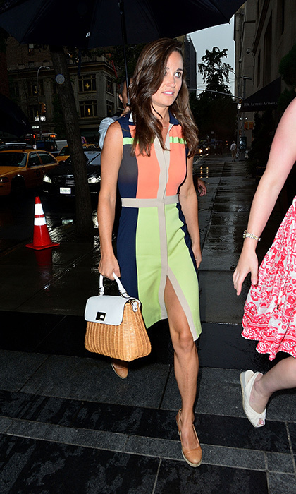 A bright color-blocked dress with lime green and orange panels with her go-anywhere purse.