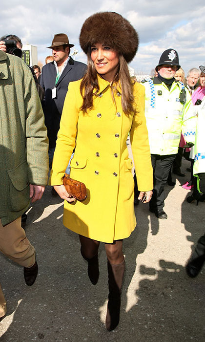 Pippa looked warm and stylish in a banana yellow coat and fur hat.