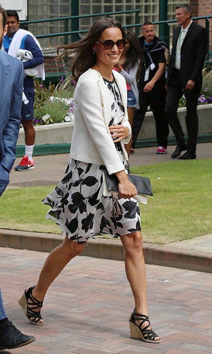 Pippa topped this floaty black-and-white print dress with a white knit jacket.