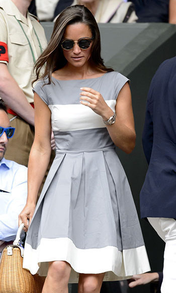 Pippa styled this grey-and-white color-blocked dress with her favorite wicker summer handbag.