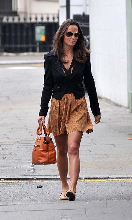 Ever the street style pro, Pippa rocked a neutral tan-and-black dress and blazer look, which she expertly accessorized with a tan handbag and nude flats.