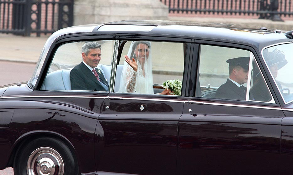 Fans got a first look at the bride as she waved to the crowds, while riding in the back of a spiffy Rolls Royce Phantom VI.