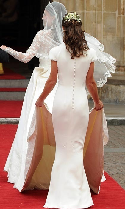 Kate's sister and maid of honor, Pippa, held the nine-foot train as the bride-to-be walked into the Abbey. It was Pippa's grand debut as the world's most famous sister, with her shapely figure garnering plenty of fans.