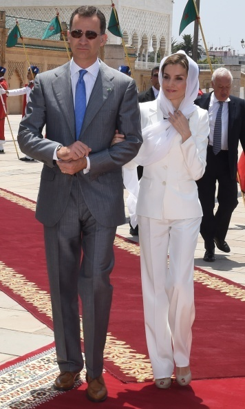 While visiting Morocco with her husband in July 2014, Queen Letizia kept cool in an all white Felipe Varela suit and peep toe pumps.
