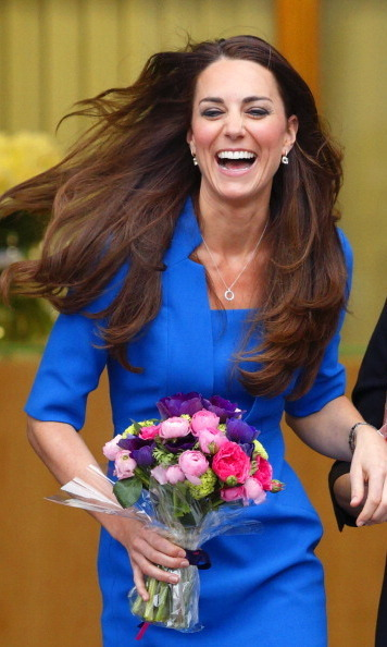 A laughing Kate (and her gorgeous shiny mane of hair) took center stage in England.