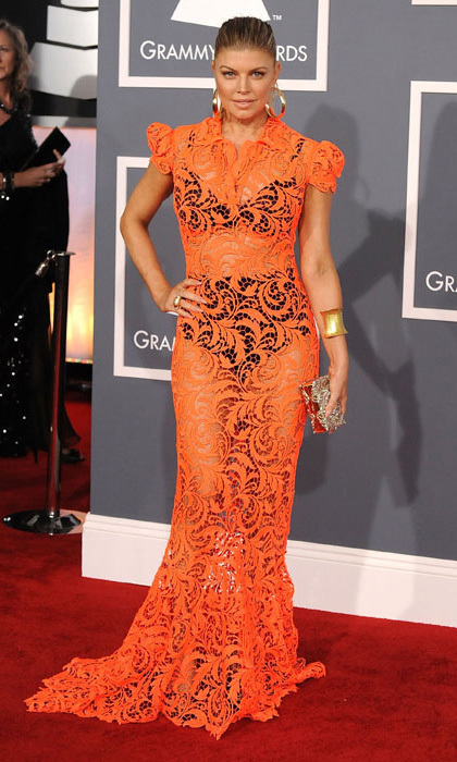 In 2012 Black Eyed Peas singer Fergie wowed in a lace tangerine dress. The star wore visible black undergarments under the Jean Paul Gaultier creation, which she matched with a gold bangle and earrings.