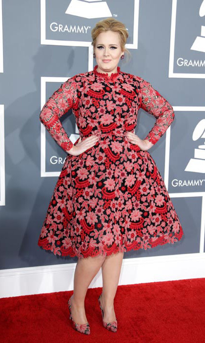 "Not only did Adele wow on stage with her performance of ""Set Fire to the Rain,"" but she also turned heads on the red carpet in this floral Valentino dress. 