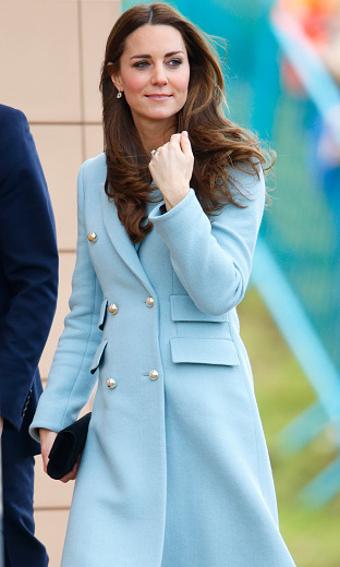 The Duchess of Cambridge has worn a number of blue coats throughout her pregnancy like this Matthew Williamson one on November 8, making some believe she's hinting at the baby's gender. 