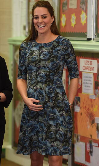 Really showing off her bump, Kate wore a figure-hugging Seraphine dress as she visited Cape Hill Children's Centre on February 18. 