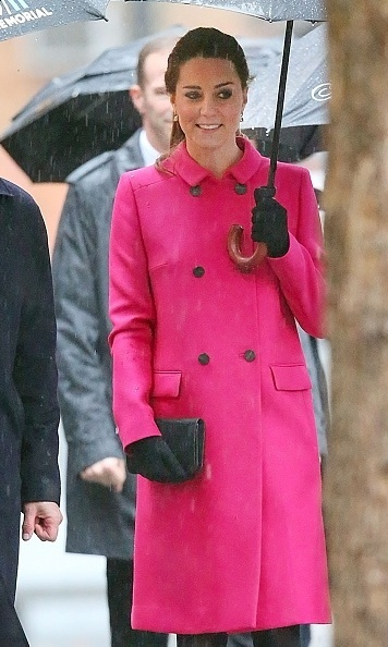 Kate glowed on a rainy day in New York City in a pink Mulberry coat while she visited the September 11 Memorial on December 9. 