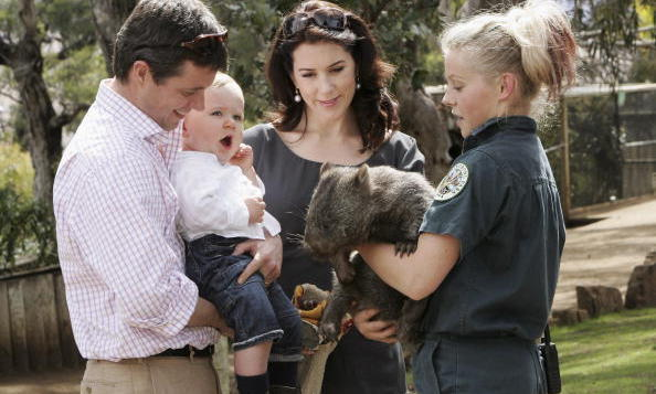 A staff member of the Bonorong Wildlife Park introduces a koala to Denmark's Crown Princess Mary and her husband Prince Frederik, holding their one-year-old son Christian as they visit the park located on the outskirts of Hobart in November 2006. <br>  Photo: Getty Images