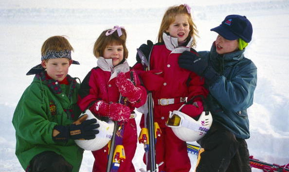 January 1995: My how they've grown! Twenty years later, Eugenie, Beatrice, Harry and William are as close as can be. Here, they were playing in the snow during a family trip to Klosters, Switzerland.