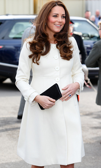 "Kate Middleton visited the set of ""Downton Abbey"" at Ealing Studios on March 12 looking radiant in a cream Jojo Maman Bebe coat.