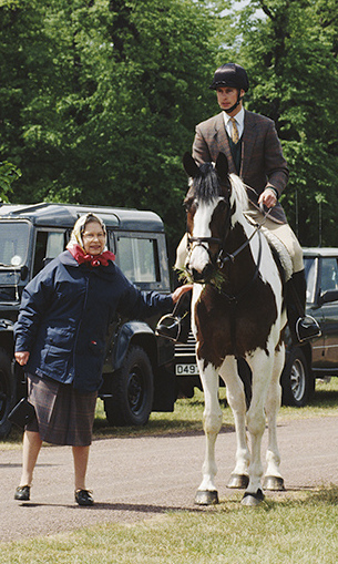 Right at home with riding and Range Rovers – and youngest son Prince Edward – in 1993.