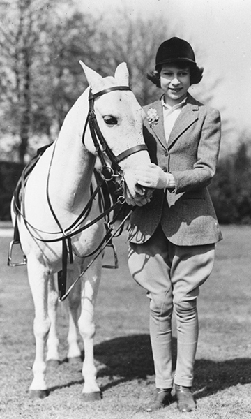 The Queen's love of horses is a lifelong one. Her Majesty had her first riding lesson at the age of 3 and was given her first pony, a Shetland mare, by her grandfather King George V when she turned 4. Here is the then-Princess on her 13th birthday in April 1939.