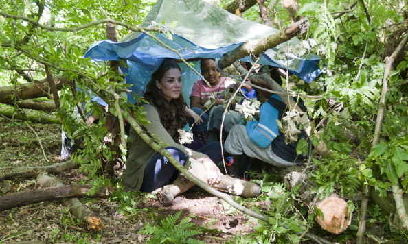 Kate wasn't afraid to get a bit dirty while camping with some scouts.