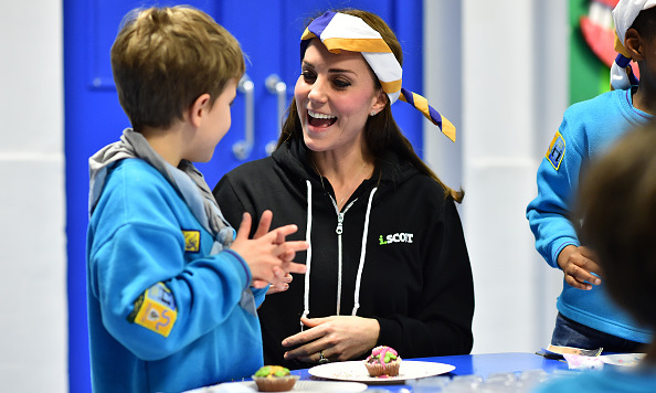 Wearing a hoodie, Kate even blindfolded herself while playing with some local children.