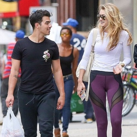 "Model of the year, Gigi Hadid was spotted walking with Joe Jonas in NYC's Soho neighborhood wearing seriously cool ""Phantasm"" leggings in plum by Michi.