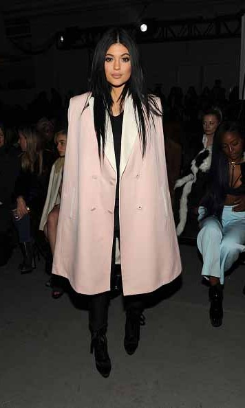 Kendall's younger sibling is renowned for her bold fashion sense. Her she is in an oversized cape at New York Fashion Week.