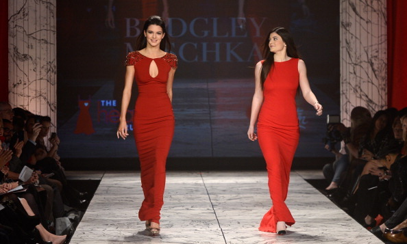 The Jenner sisters walk the runway together at The Heart Truth 2013 Fashion Show at Hammerstein Ballroom. 