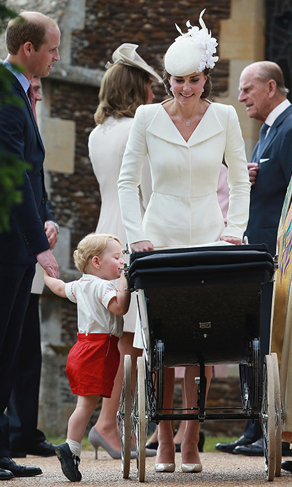 The Cambridges made their debut as a family of four at Princess Charlotte's christening on July 5, 2015, when the world was charmed not only by guest of honor Charlotte, but also her big brother, curious Prince George. The Princess arrived at the service in Queen Elizabeth's vintage carriage, while little George made headlines for his Rachel Riley outfit, which was a near-copy of one once worn by his dad.