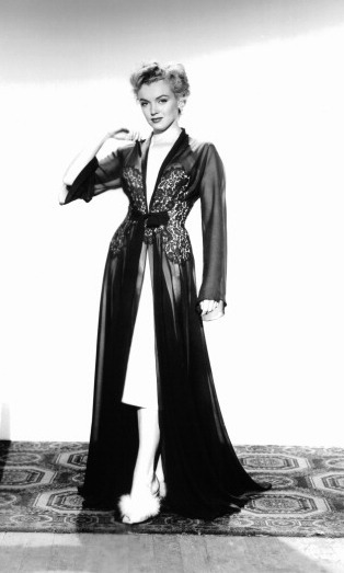 Never afraid to wear lingerie on screen, the rising star wore a silk robe for the drama 'Dont Bother To Knock' in 1952. 