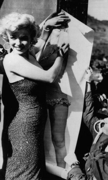 The buxom blonde dazzled U.S. military troops in a sparkly dress to sign autographs during the Korean War.