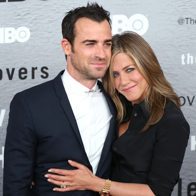 The actress cuddles up to <i>The Leftovers</i> star Justin at the show's premiere in New York City.