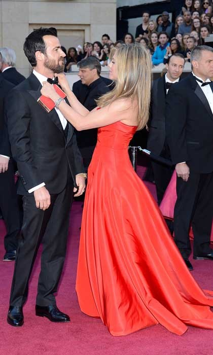 The <i>Friends</i> actress keeps her man looking sharp by adjusting his bow-tie at the 2013 Academy Awards.