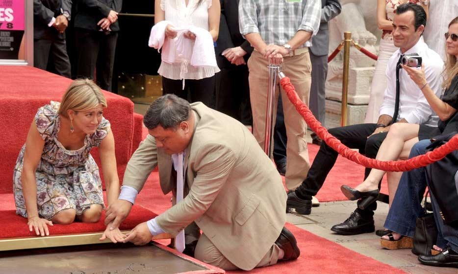 Justin lovingly looked on as Jennifer was immortalized at Grauman's Chinese Theatre in 2011.