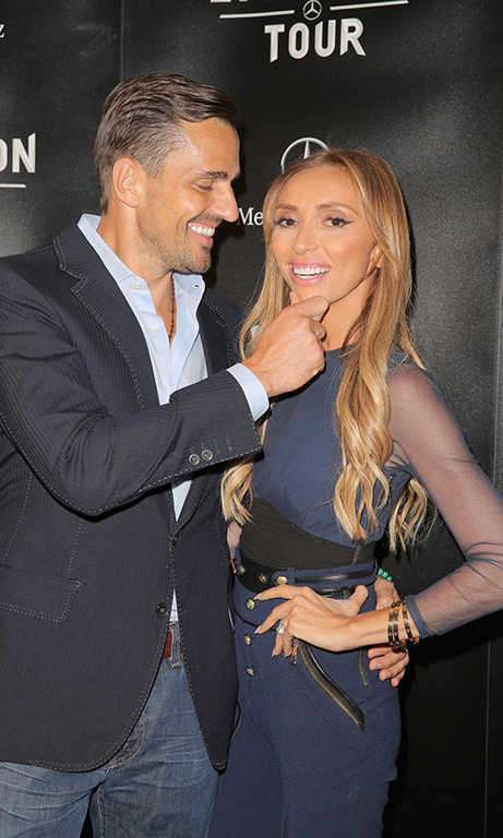Aug 4: Giuliana and Bill Rancic cuddled up during the Mercedes-Benz Evolution tour. 