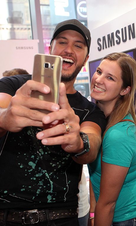August 13: Luke Bryan posed for a selfie with a fan after taking the stage during the Galaxy event at the Samsung Soho Studio in New York City.
