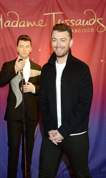 August 10: Cool crooner Sam Smith couldn't help but smile during the unveiling of his wax figure at Madame Tussauds in San Francisco.