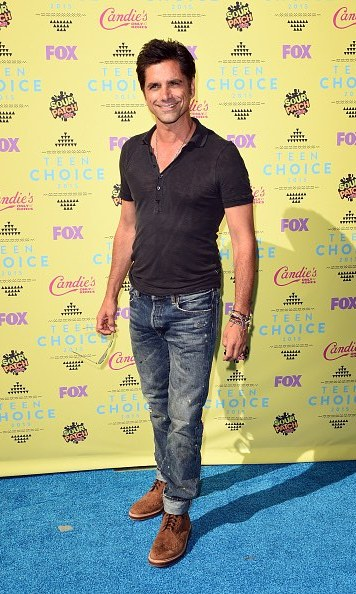Yes, John Stamos can look totally handsome in just a jeans and t-shirt.