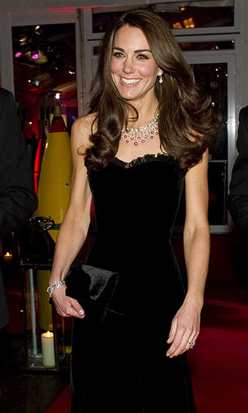 Adding a pop of color to her black velvet Alexander McQueen gown, Kate turned heads in a ruby-and-diamond necklace and matching bracelet by luxury designers Mouwad for the <I>Night of Heroes: The Sun Military Awards</I> in 2011.