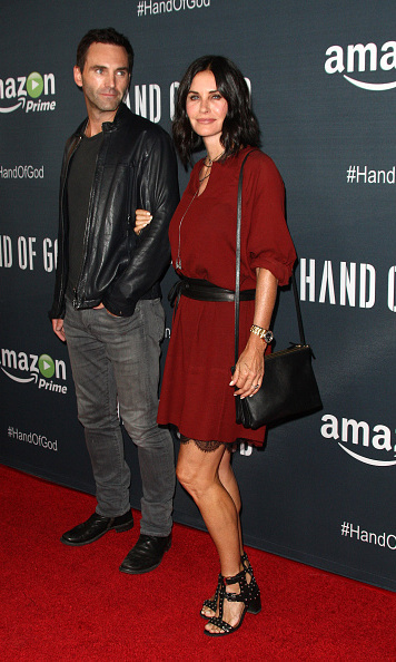 August 19: Courteney Cox showed off her toned legs with fiance Johnny McDaid during the 'Hand of God' premiere in L.A.