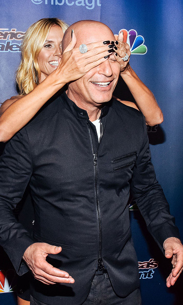 "August 19: Hedi Klum gave Howie Mandel a friendly surprise on the 'America's Got Talent"" carpet in New York City. 