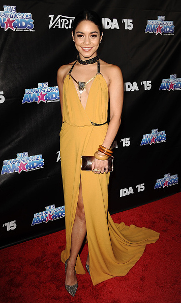 August 19: Vanessa Hudgens hid her hand with the cast behind her back as she posed on the carpet at the 2015 Industry Dance Awards Cancer benefit show in L.A.
