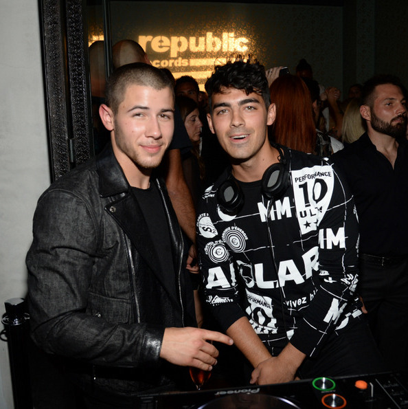 August 30: Nick Jonas stopped by the DJ booth to check on big bro Joe as he supplied the music at the Republic Records VMA bash in West Hollywood.