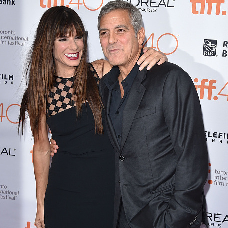 Septmeber 11: Sandra Bullock and George Clooney brought the LOLs to the 'Our Brand in Crisis' premiere at the Toronto International Film Festival.