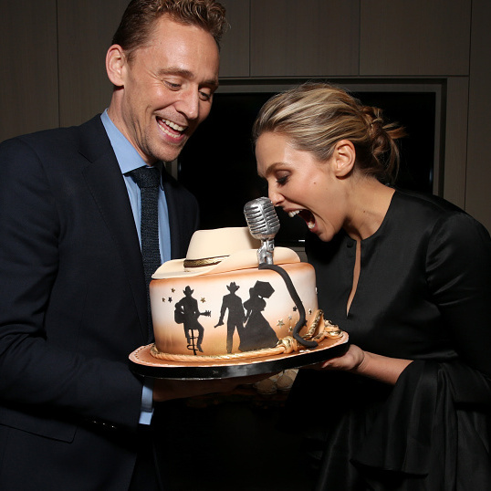 September 11: Tom Hiddleston and Elizabeth Olsen couldn't resist taking a bite out of that cake during Sony Pictures Classics after-party for 'I Saw The Light' sponsored by Lacoste and Ciroc at The Addison Residence in Toronto.
