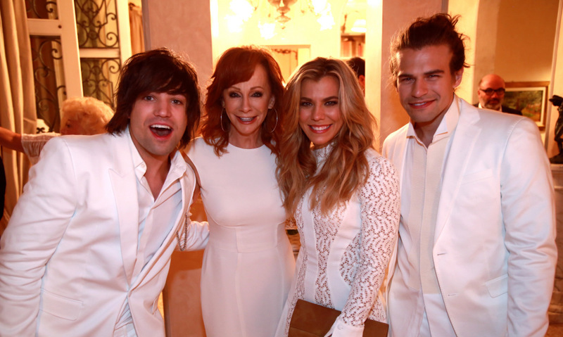 September 13: Country does Firenze! The Band Perry and Reba McEntire, who was honored during the five days of parties, wore their white after Labor Day for the 2nd Annual Celebrity Fight Night in Italy with Andrea Bocelli in Florence.