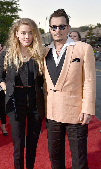 "September 15: Amber Heard and Johnny Depp proved that there isn't a read carpet that they can't heat up during the ""Black Mass' screening in Boston.  